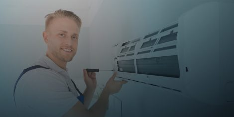 Contractor providing air conditioning system tune-up in Edmond, OK.