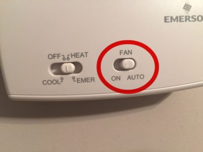 Thermostat image pointing out Fan should be set to Auto to save on energy bills in Edmond, OK